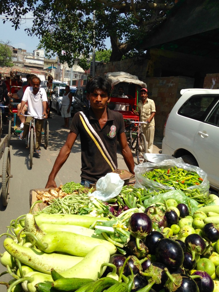 Young man with vegetable cart